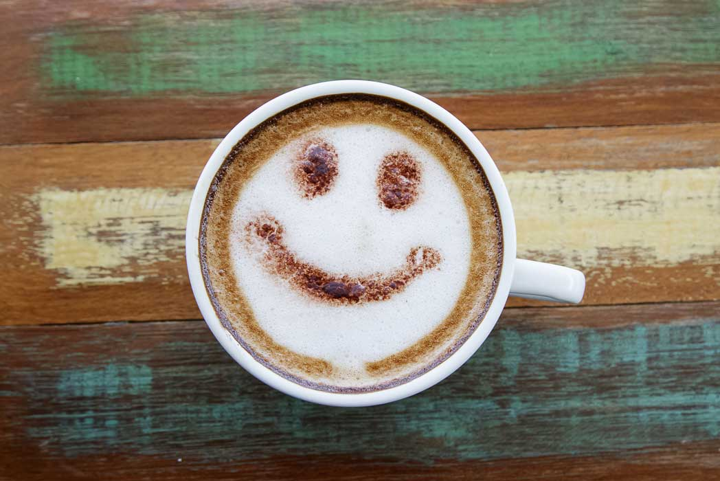 Coffee First Smiling face on cup of coffee